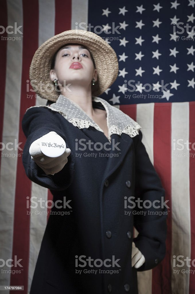 Woman Voter holding a We the People button stock photo