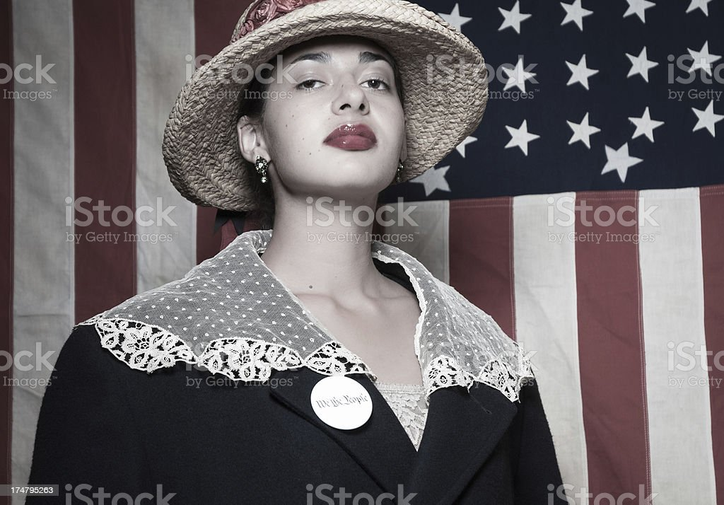 Woman voter wearing We The People button stock photo