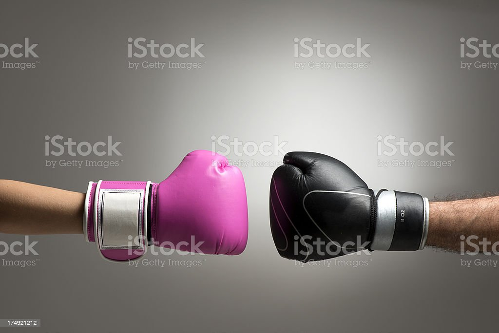Woman vs. Man stock photo