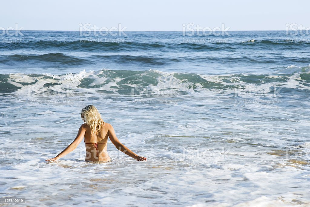 Woman Wading in Ocean royalty-free stock photo