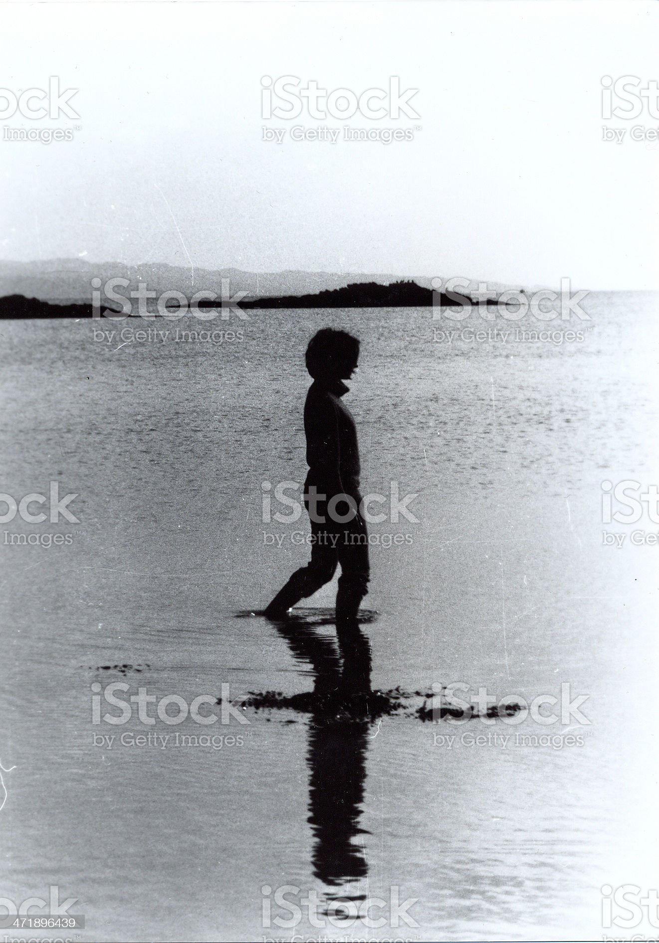Woman wading the sea royalty-free stock photo