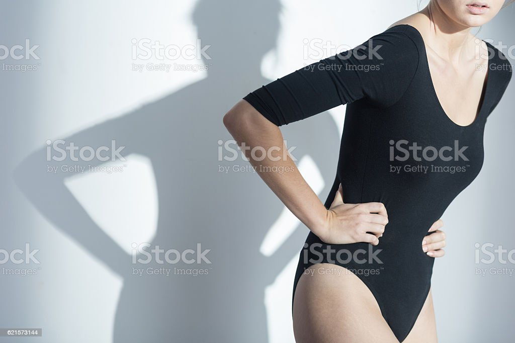 Woman waering holding her stomach stock photo