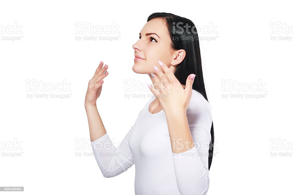 woman wafting air to nostrils stock photo