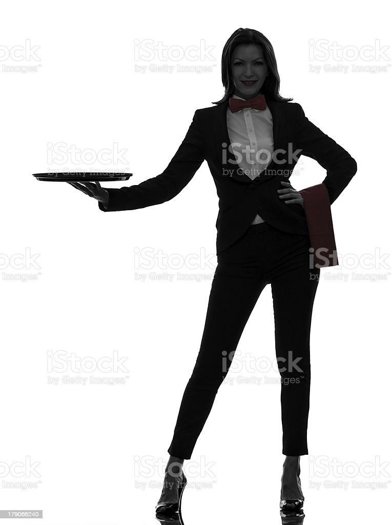 woman waiter butler holding empty tray  silhouette royalty-free stock photo
