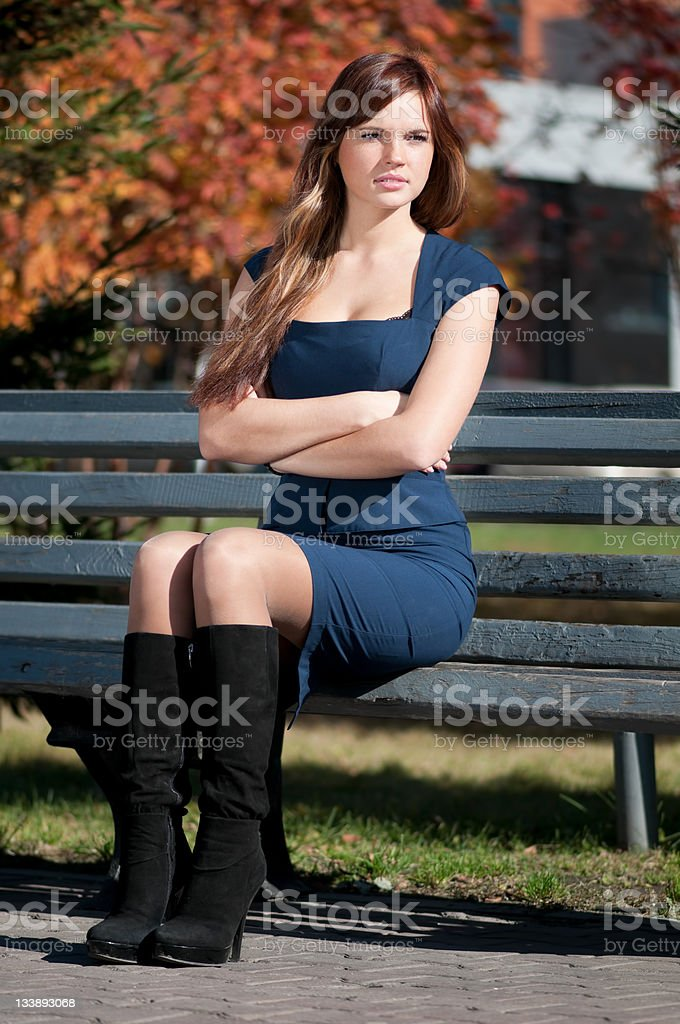 Woman waiting a meeting at park stock photo