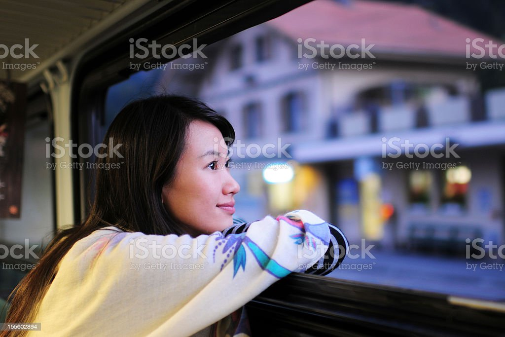 Woman Waiting and Looking Through Window - XLarge stock photo