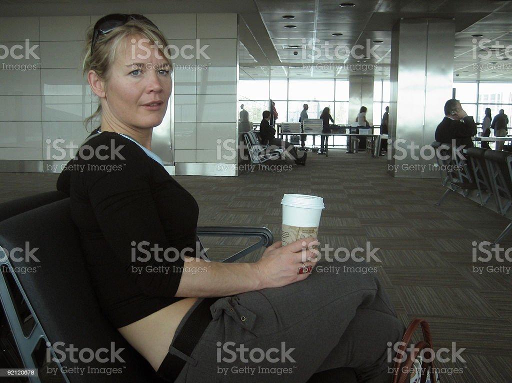 Woman waiting at airport royalty-free stock photo