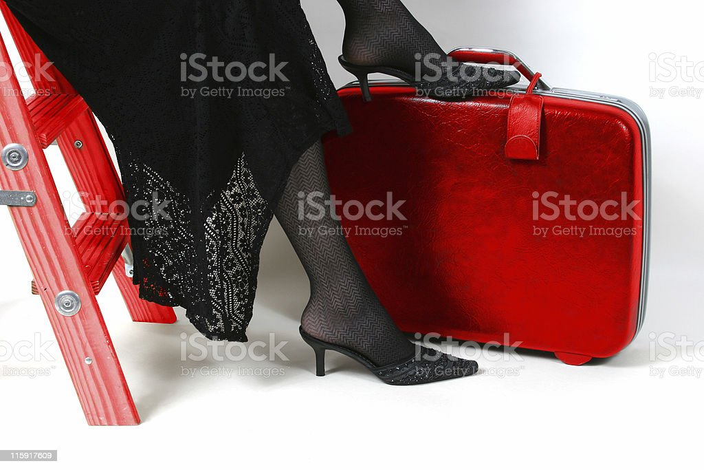 Woman waiting beside her bag, she is being impatient. royalty-free stock photo