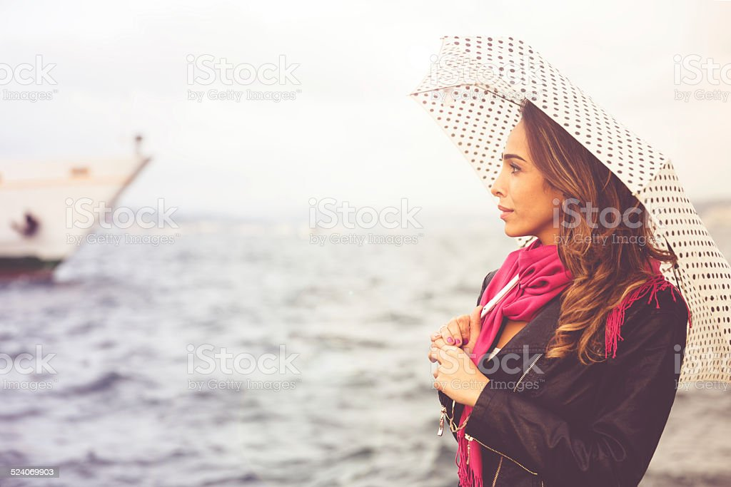 Woman Waiting For Ferry Boat On Boshorus stock photo