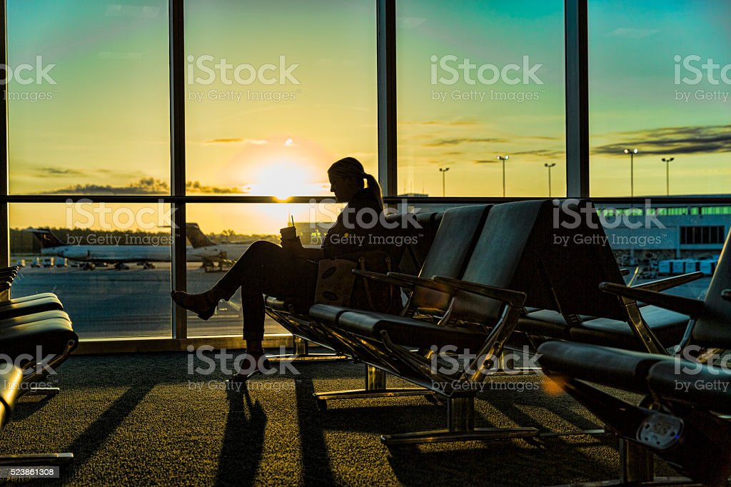Woman Waiting for Her Flight Early Morning stock photo