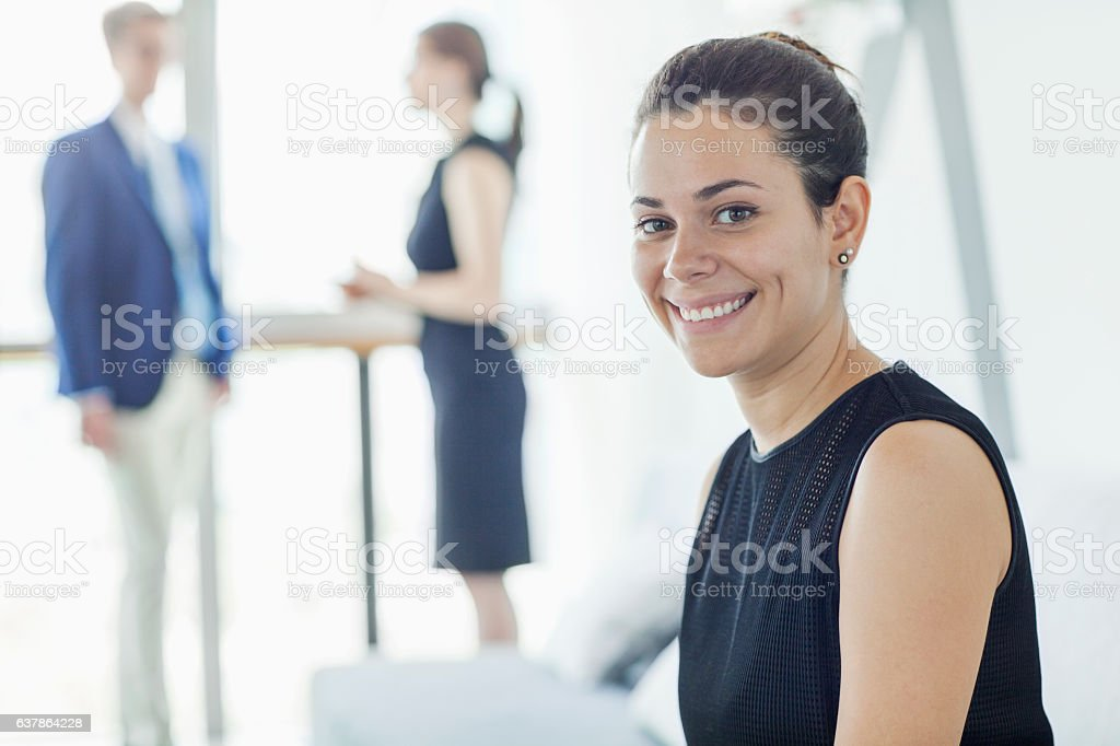 Woman waiting for interview in lobby stock photo