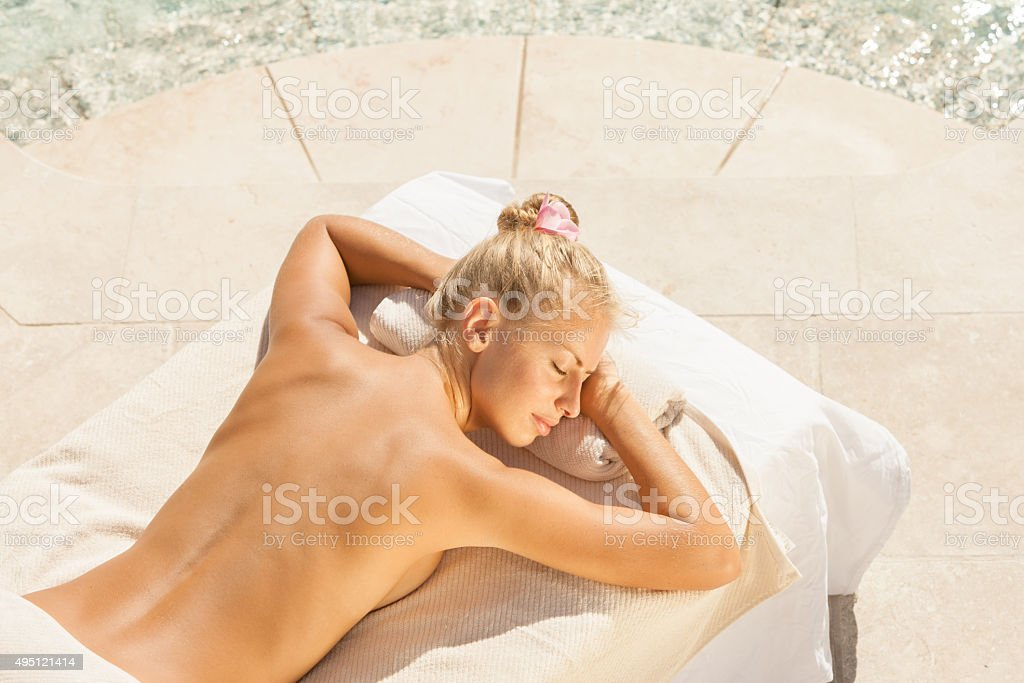 woman waiting for massage treatment at a luxury spa resort stock photo