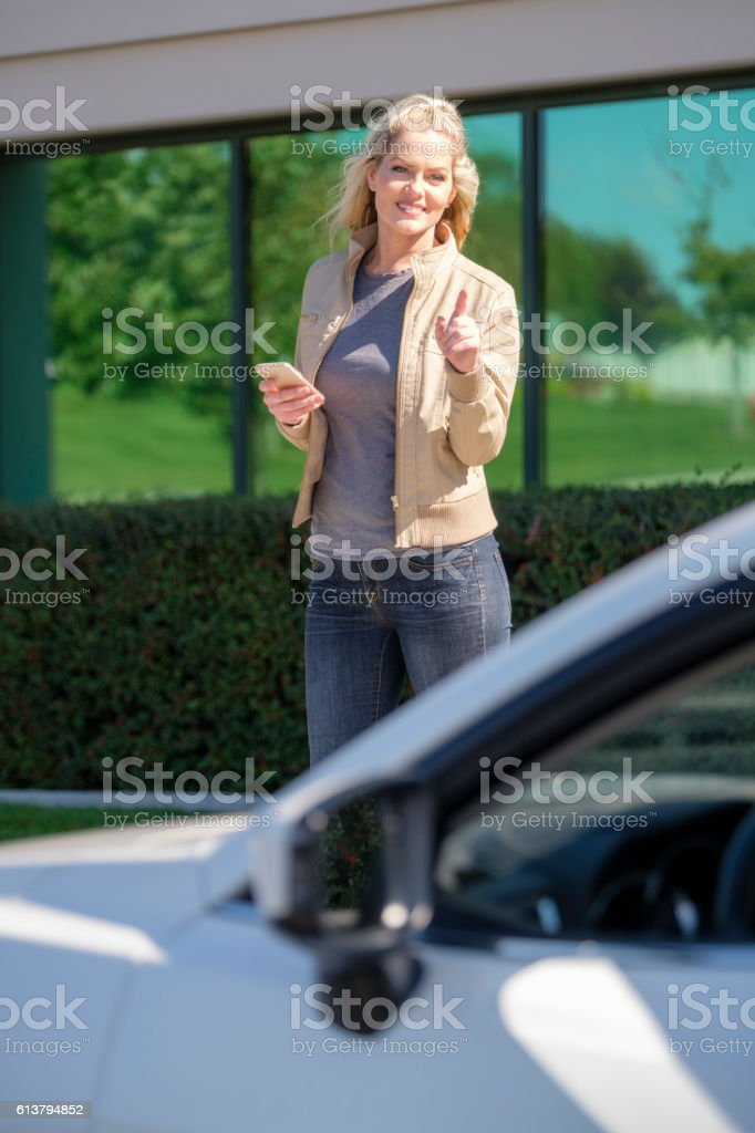 Woman Waiting for Ride Share Taxi stock photo