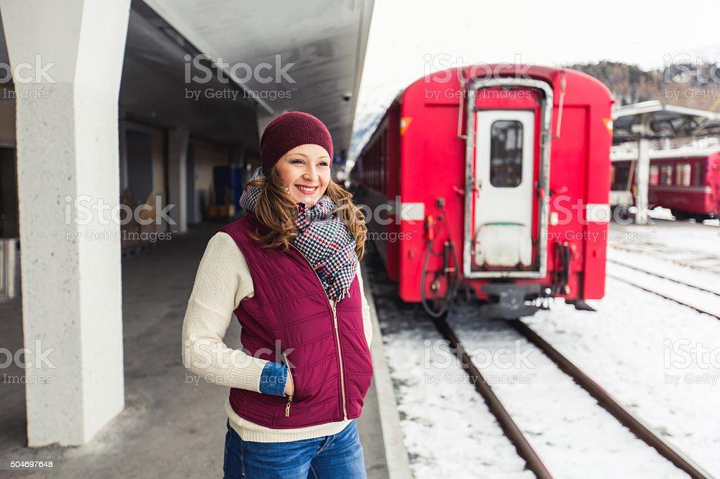 Woman waiting for subway train stock photo