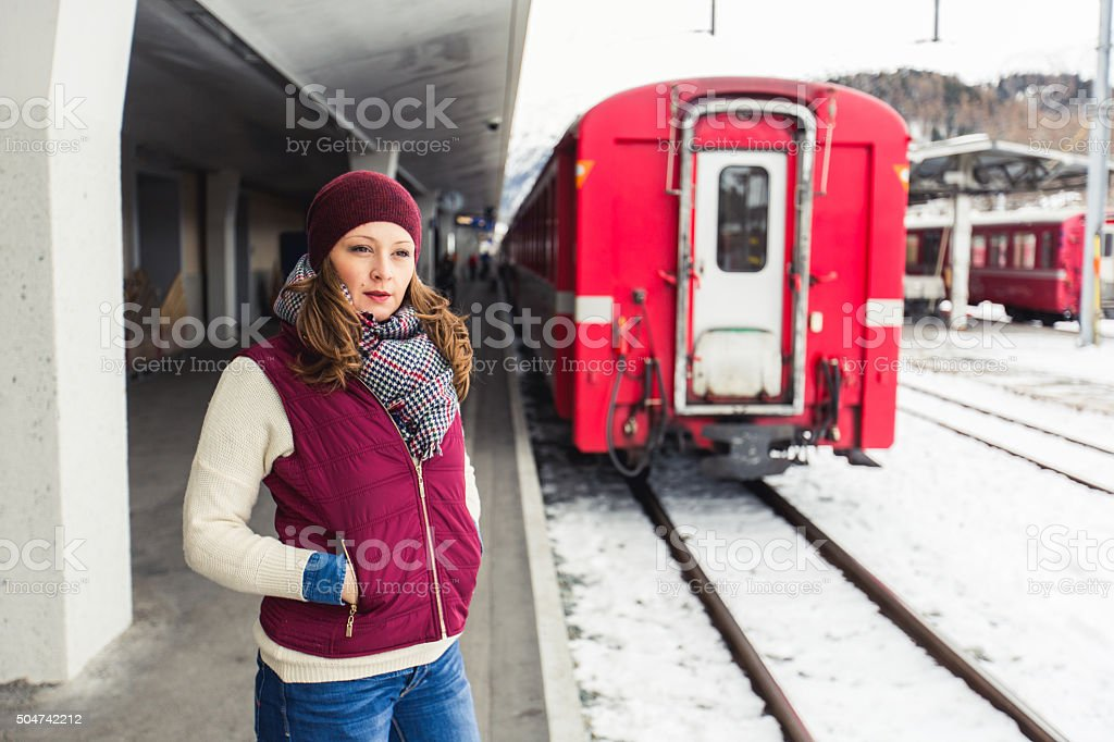 Woman waiting for subway train stock photo