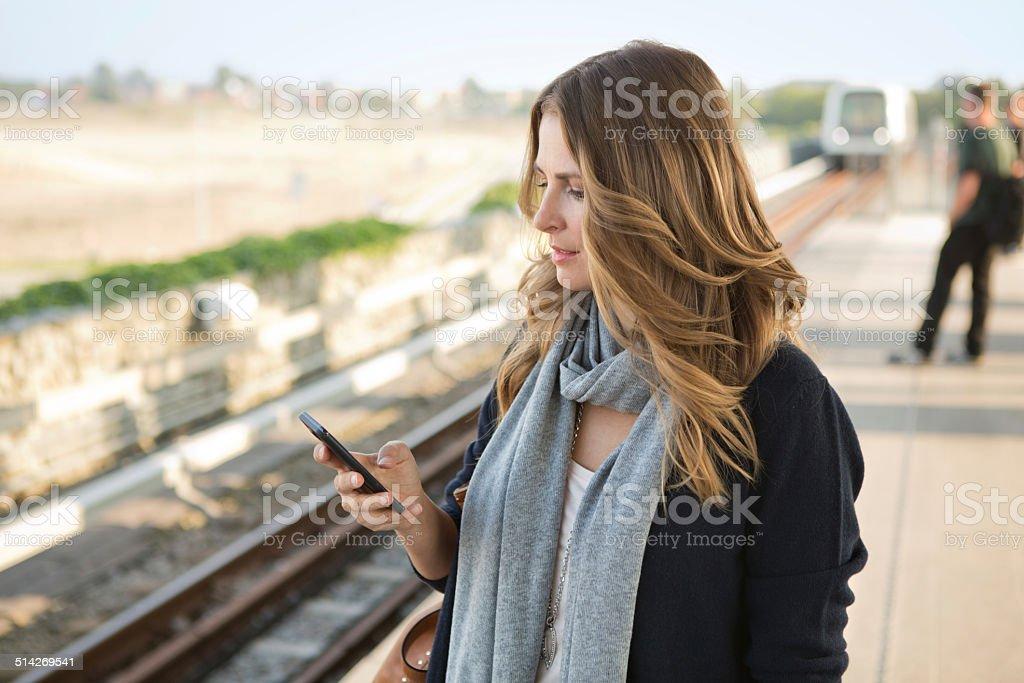 Woman waiting for subway train. stock photo