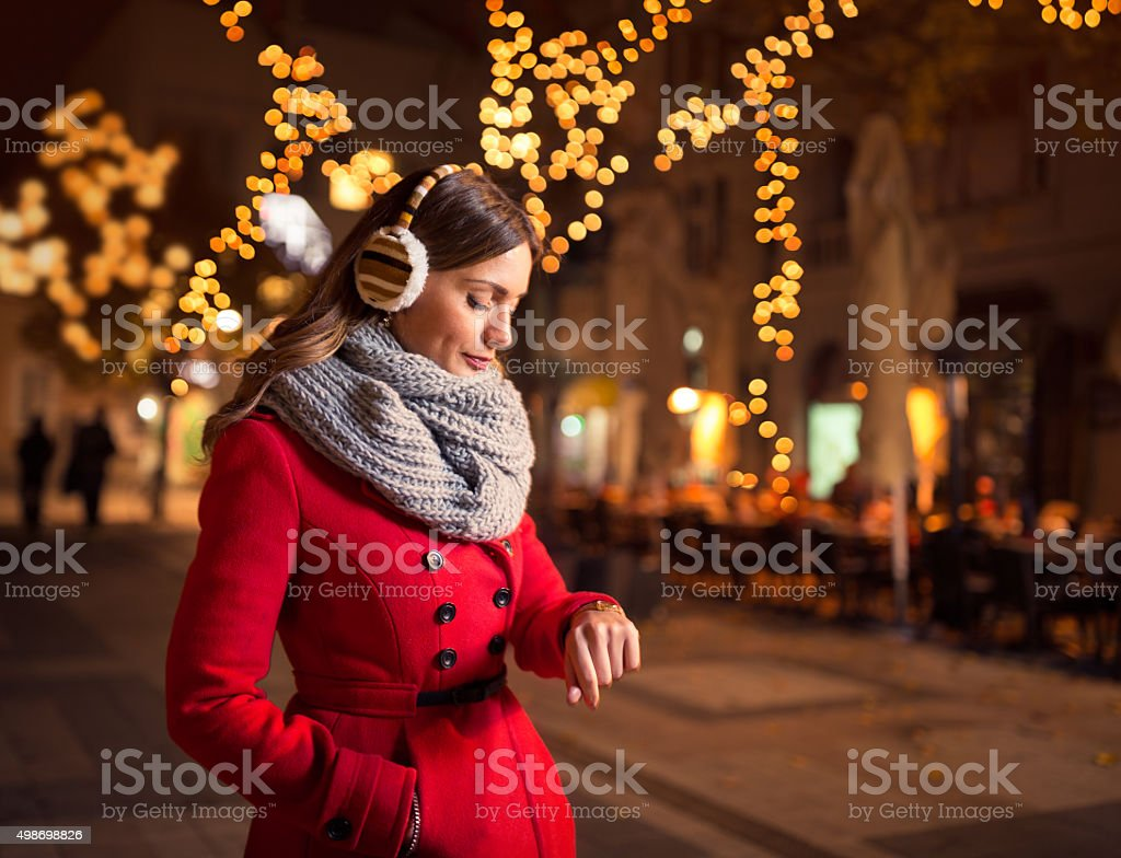 woman waiting her boyfriend who is late for a date stock photo