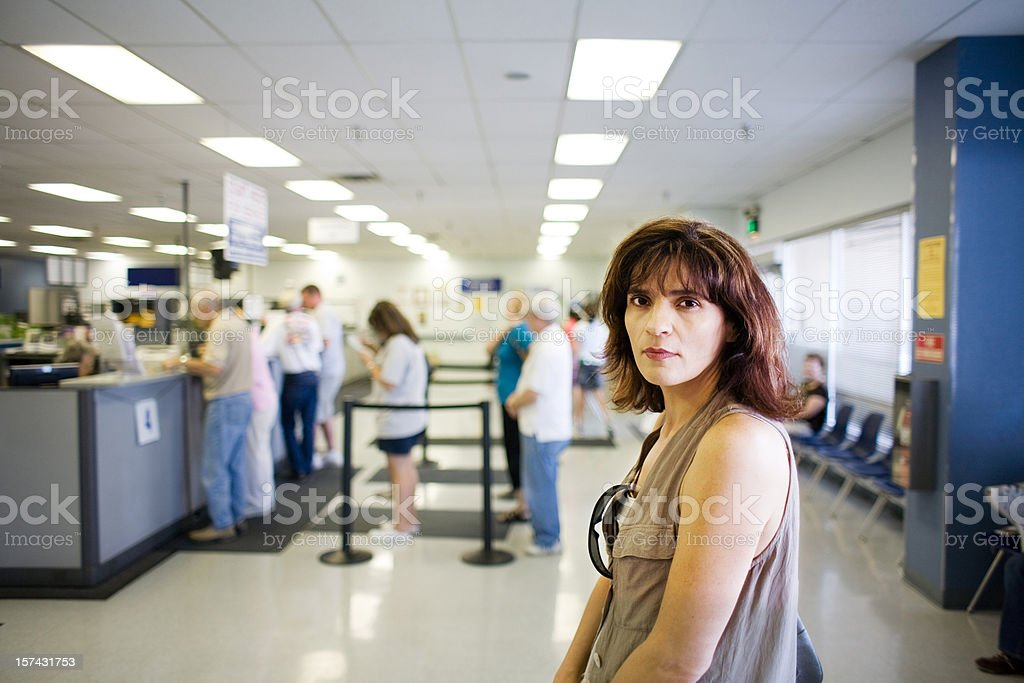 Woman Waiting in Line stock photo