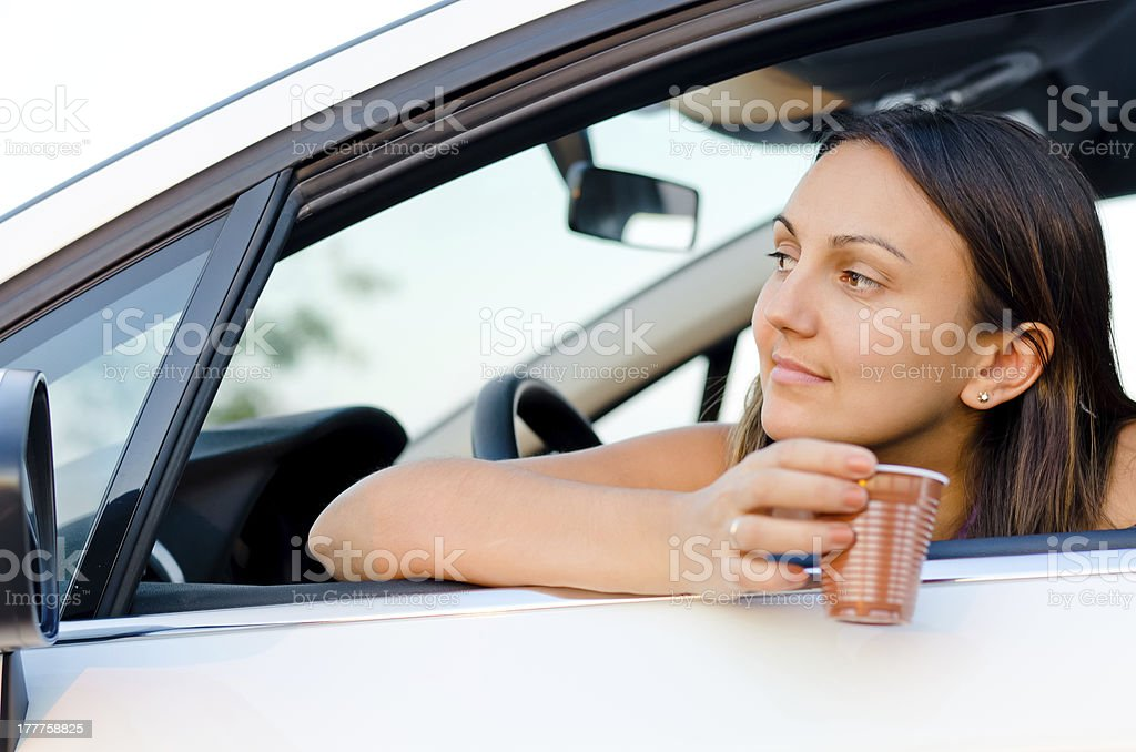 Woman waiting patiently in her car stock photo
