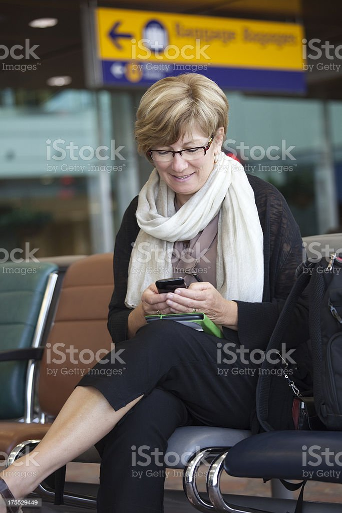 A woman waiting to board her airplane stock photo