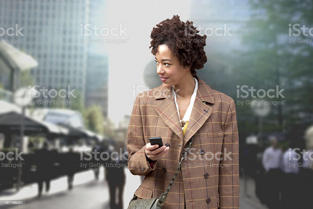 Woman waiting with a mobile phone royalty-free stock photo