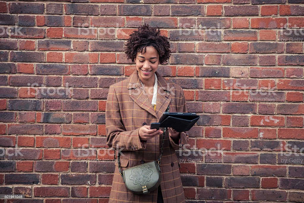 Woman waiting with a mobile phone stock photo