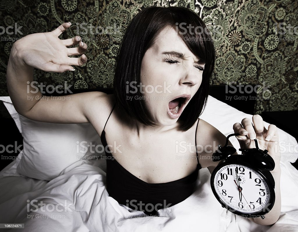 Woman waking up at yawning royalty-free stock photo