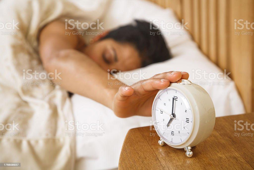 Woman waking up stock photo