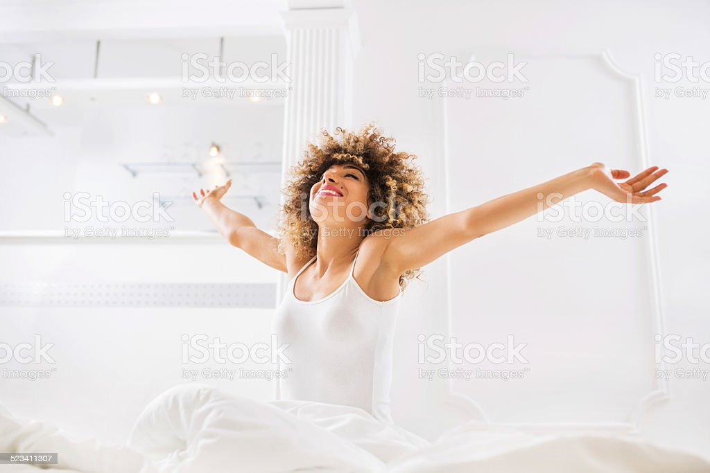 Woman waking up. stock photo