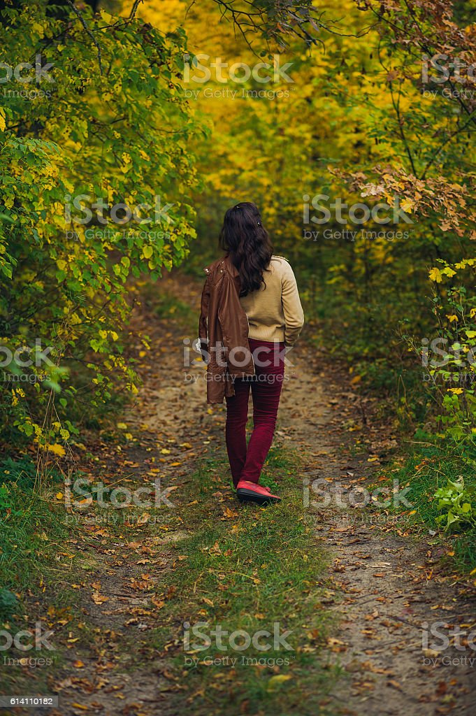 woman walk in autumn forest stock photo