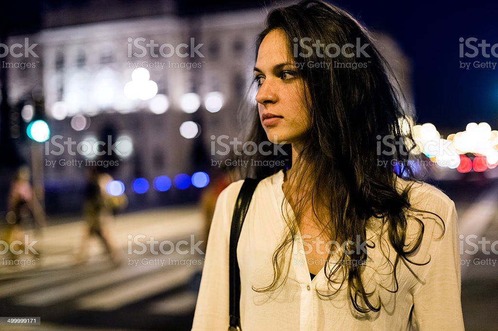 Woman walking alone at night stock photo