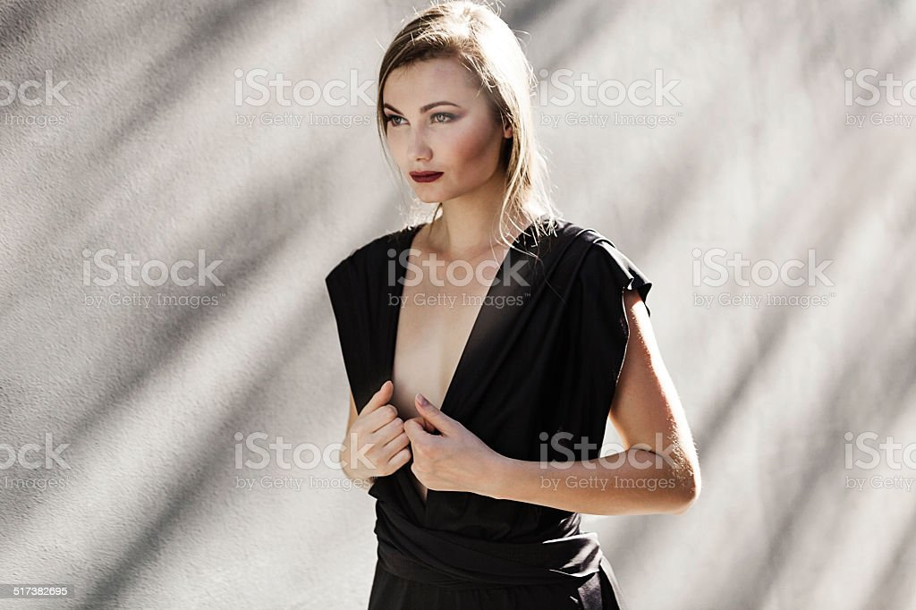 Woman walking and looking aside stock photo