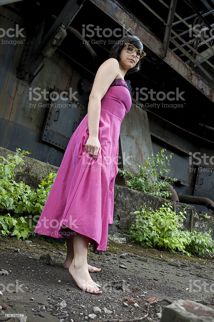 Woman walking barfoot in old factory stock photo