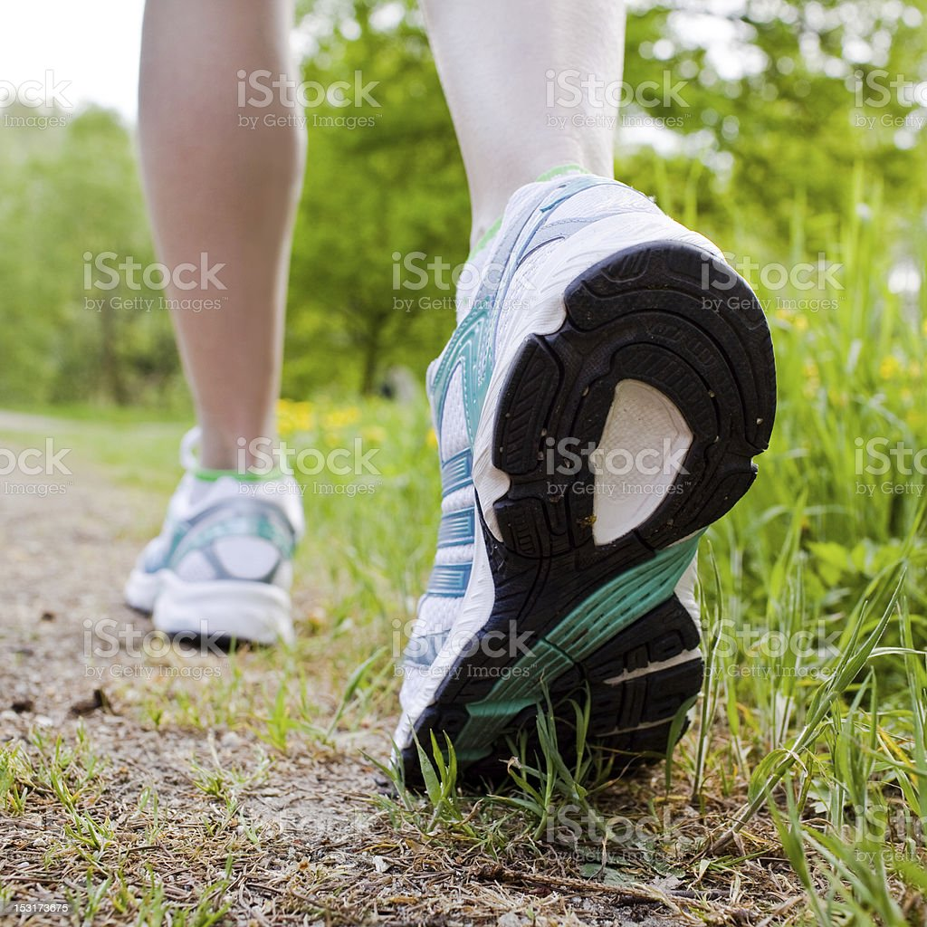 Woman walking cross country and trail in spring forest royalty-free stock photo