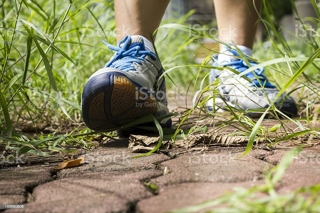 Woman walking cross country and trail royalty-free stock photo