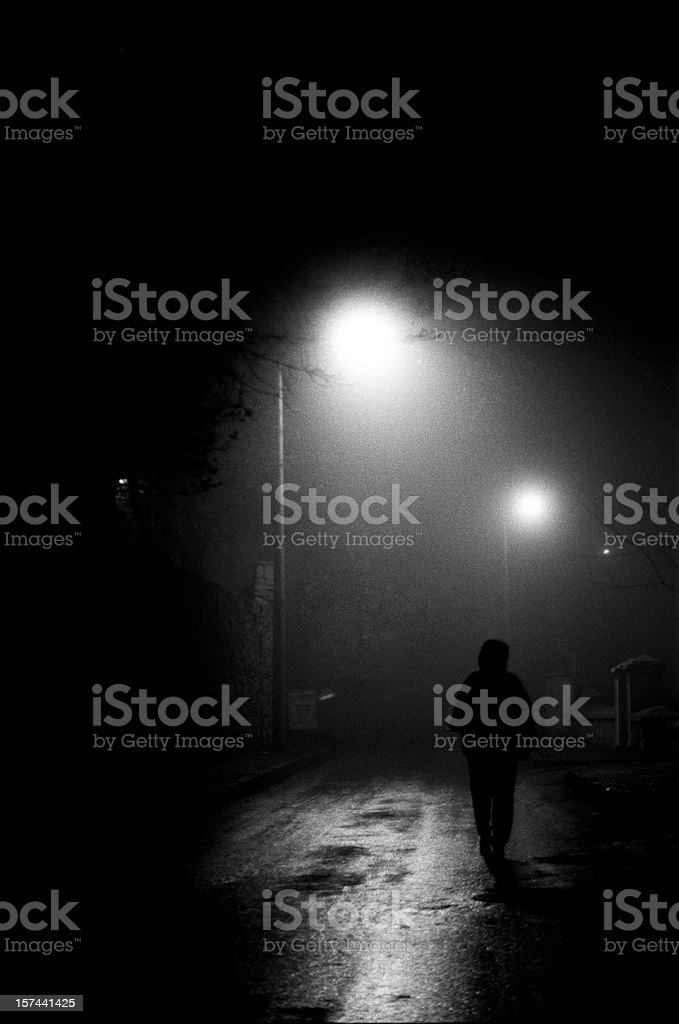 Woman walking down middle of street at night, Turkey, Istanbul stock photo