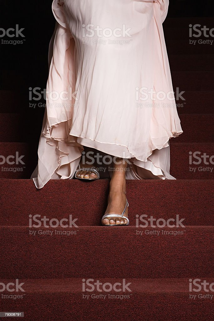 A woman walking down stairs stock photo