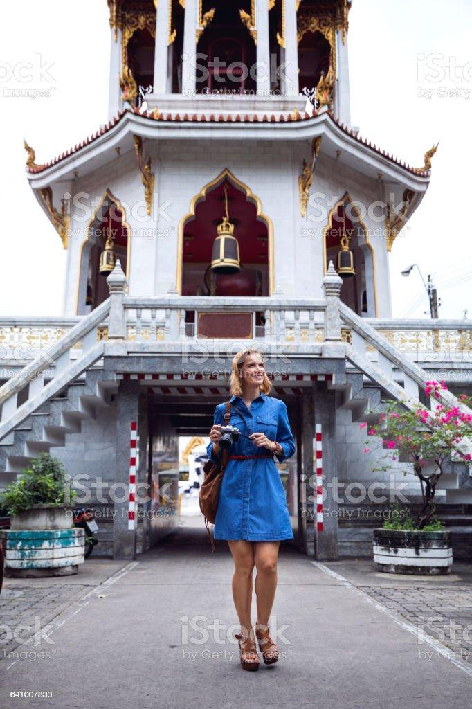 Woman walking down the street in Bangkok, exploring temple areas stock photo