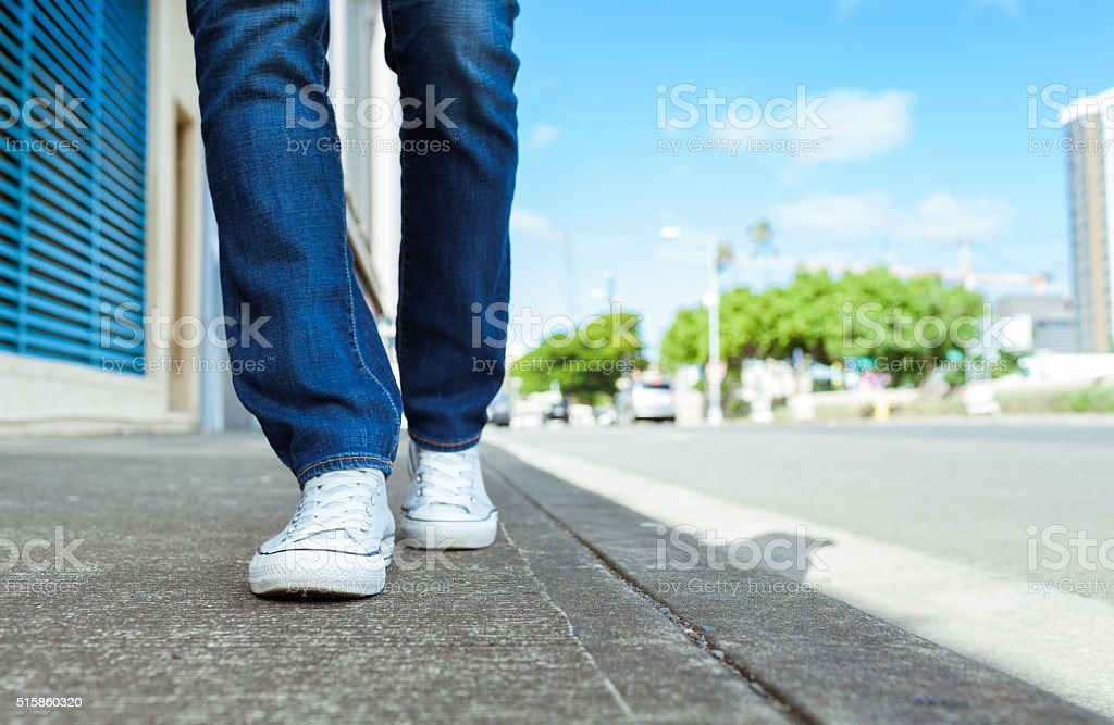 Woman walking down the street stock photo
