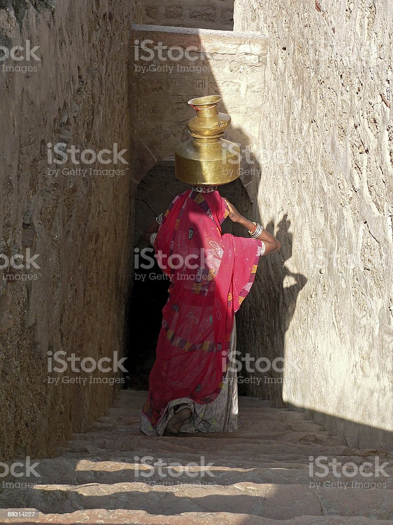 Woman walking down the well in Rajasthan, India royalty-free stock photo