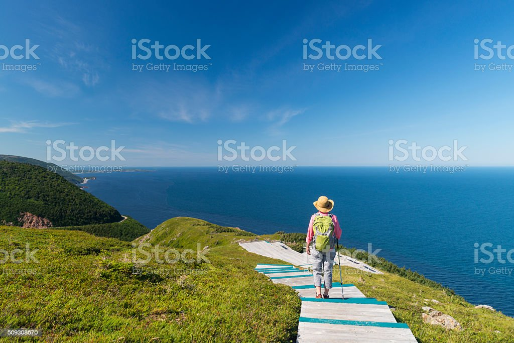 Woman walking, hiking, Skyline, Cabot trail, Cape Breton, Nova Scotia stock photo