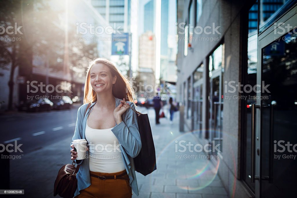 Woman walking home after shopping stock photo