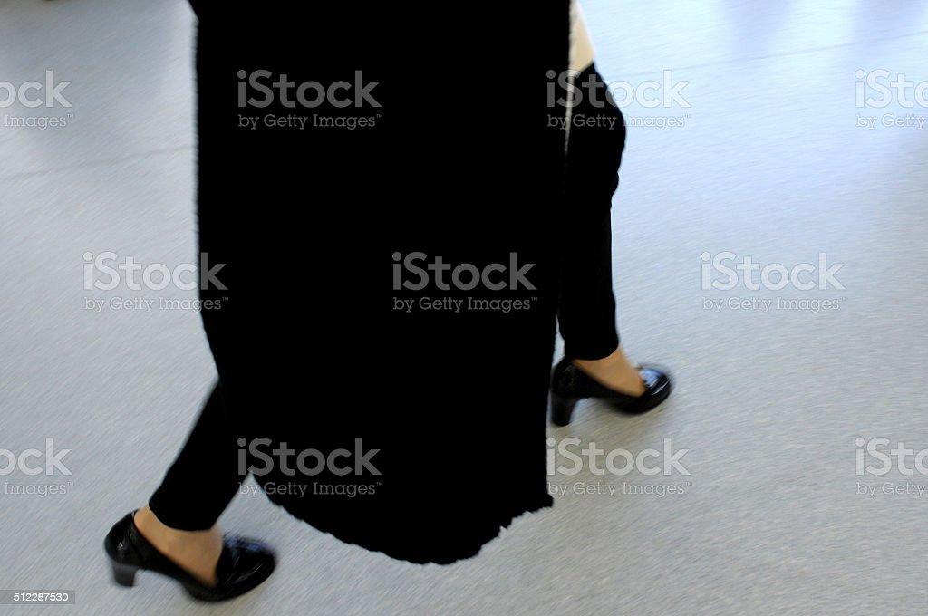 woman walking in a hurry stock photo