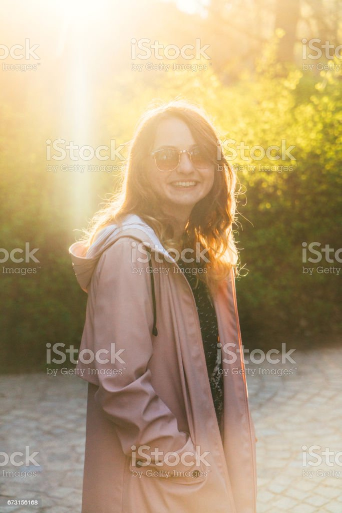 Woman walking in Łazienki Park in Warsaw  at sunset stock photo