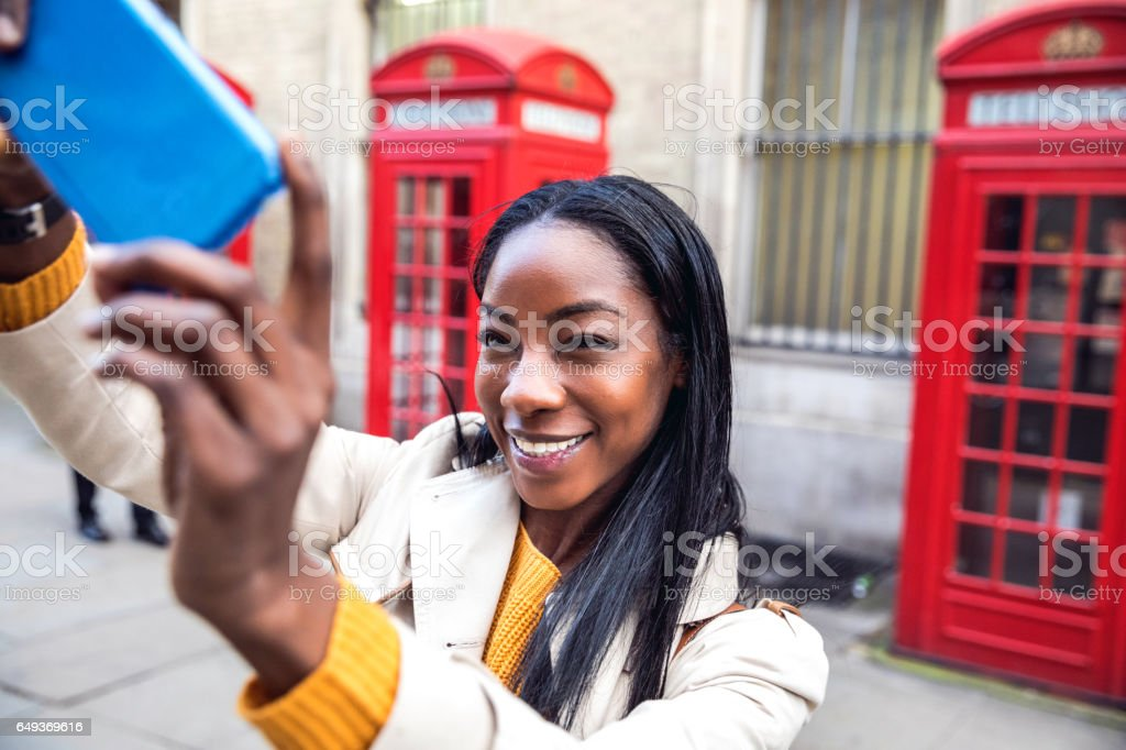 Woman walking in Central London for shopping stock photo