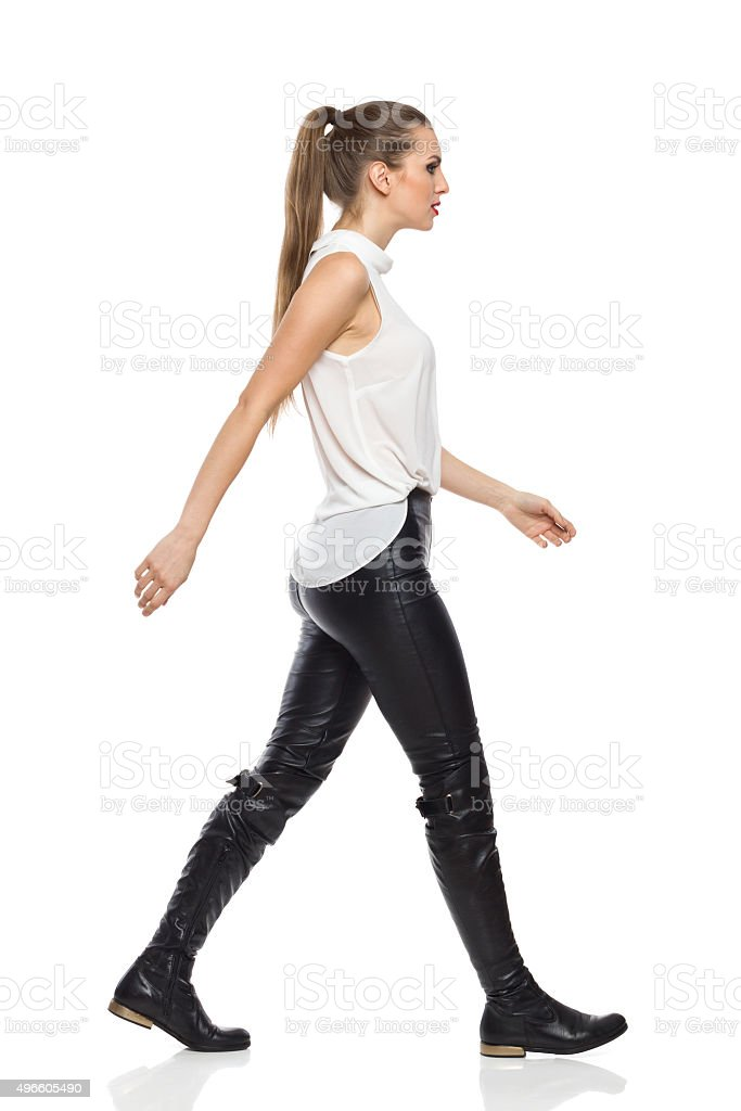 Woman Walking In Leather Trousers stock photo
