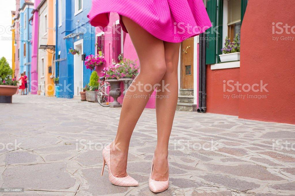 Woman walking in romantic old village stock photo