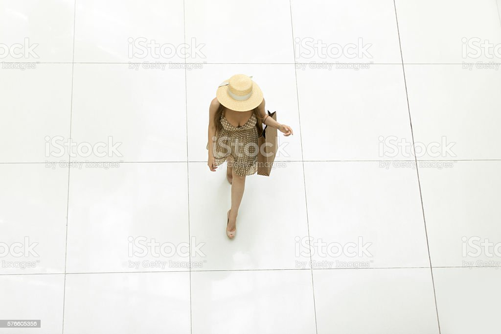 Woman walking in shopping centre. View from above stock photo