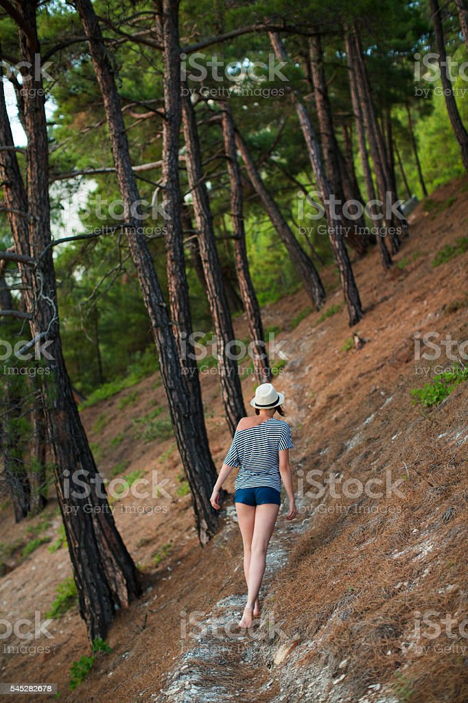 woman walking in short shorts he summer forest stock photo