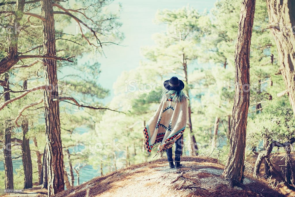 Woman walking in summer forest stock photo